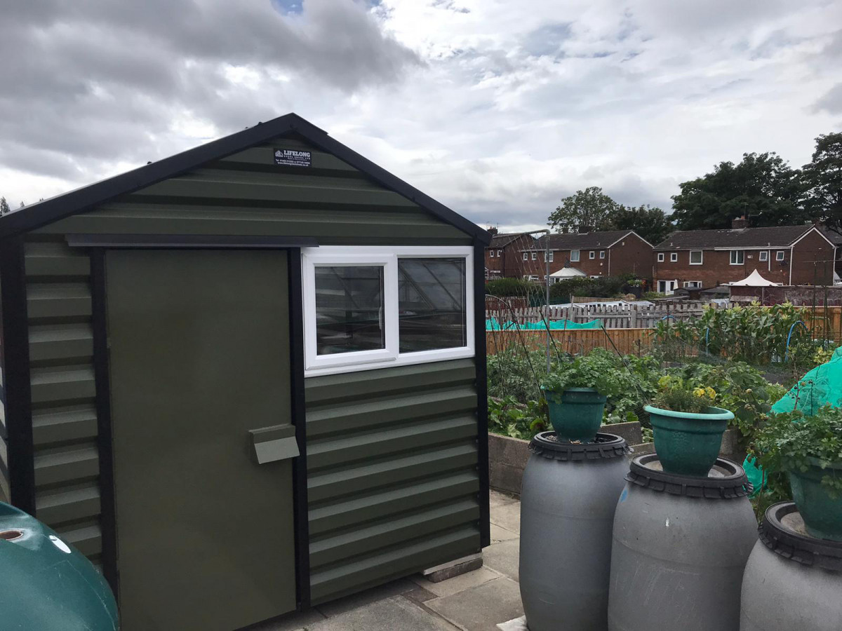 Apex Shed in Olive Green with Lock Cover