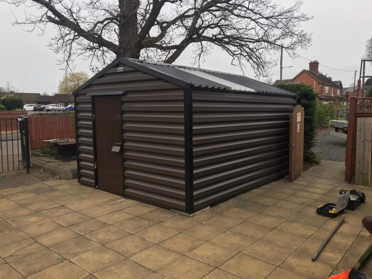 Apex shed in Vandyke Brown, no window, clear roof sheet